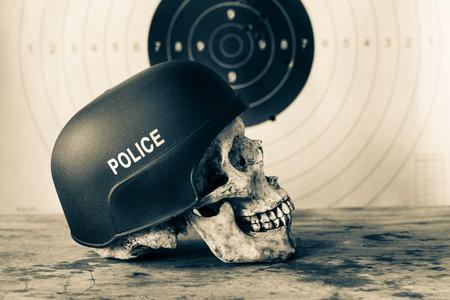 enforcer: Human skull wear police helmet with bull eye target as the background
