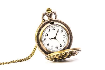 old pocket watch on white background photo