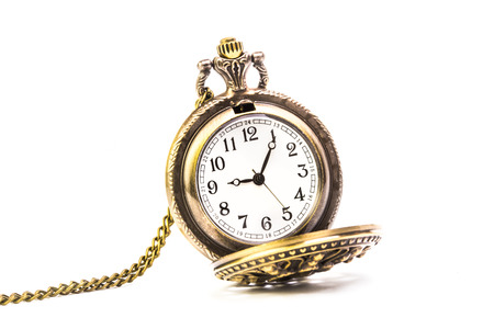 old pocket watch on white background photo