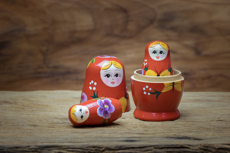 Matryoshka, a Russian wooden doll on wooden table Stock Photo