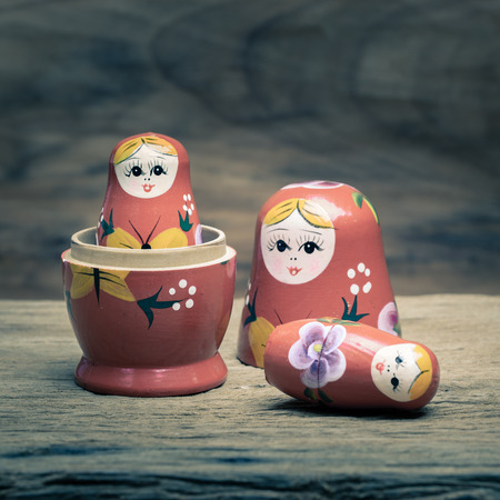 wooden doll: Matryoshka, a Russian wooden doll on wooden table Stock Photo