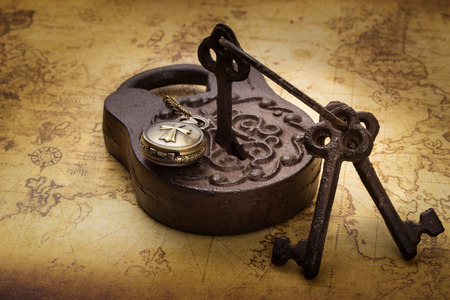 pocketwatch: Vintage old rusty padlock with keys and pocketwatch on ancient map, still life