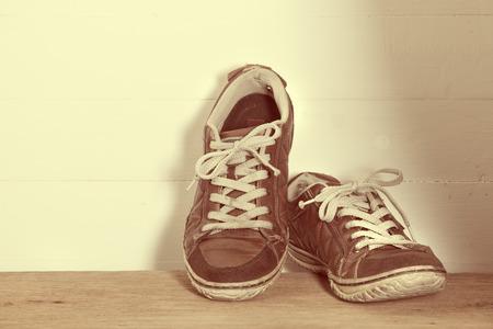 Sneakers on wooden floor photo