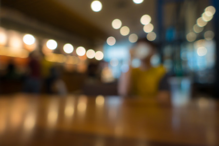 business table: Blur or Defocus image of Coffee Shop or Cafeteria for use as Background
