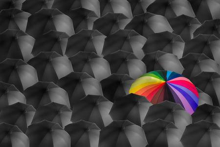 rainbow umbrella in mass of black umbrellas, different concept photo