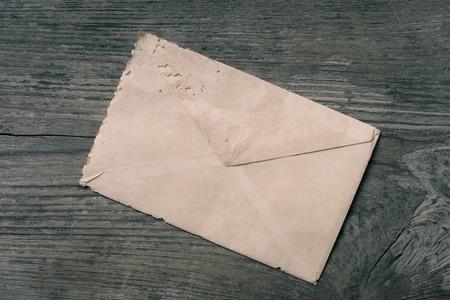 old envelope: Old envelope on dirty wooden
