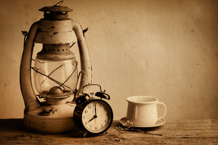 tea lamp: Still life with old lamp and alarm clock and tea cup, Stock Photo