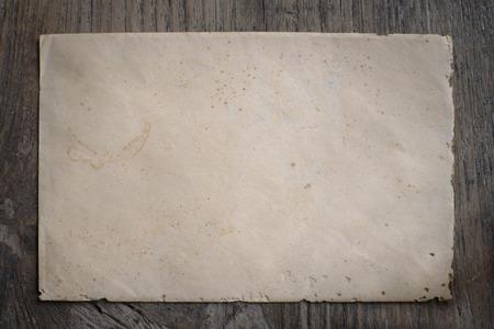 old envelope: Old envelope on weathered wood texture