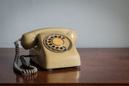 antique telephone: Retro rotary telephone on wood table