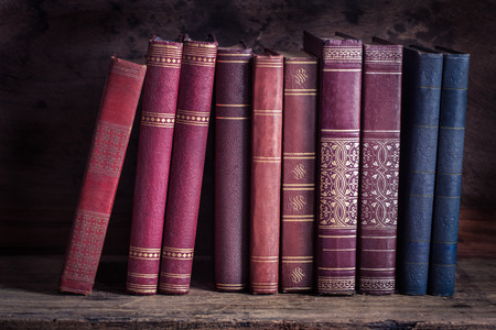 Still life with old vintage books on wooden table
