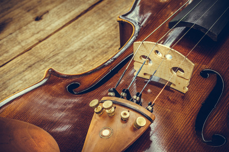 musical instrument parts: Art. Closeup of old wooden violin stringed instrument on old wooden table. Classical music. Stock Photo