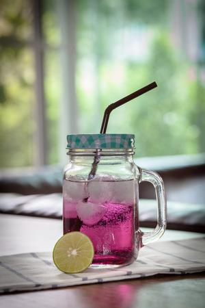 refreshment: Refreshment with lemon slice on green background