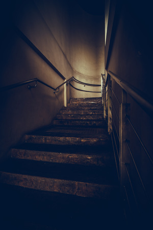 hand rail: an empty stairwell with metal hand rail, vintage or retro tone