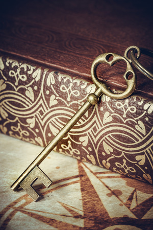 old keys: old keys on a old book, antique texture background
