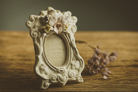 vintage photo: Still life with vintage classic photo frame and key
