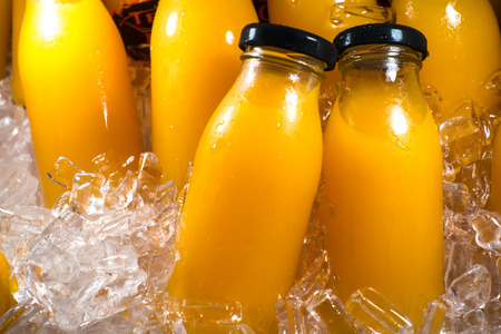 the juice: Orange juice bottles on the ice box
