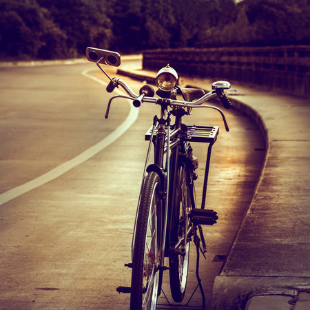 paddle wheel: Old bicycle on the bridge, vintage effect style.