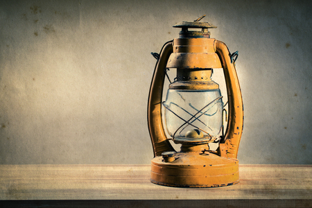 antique table: Still life old kerosene lantern on wooden table, effect by vintage style
