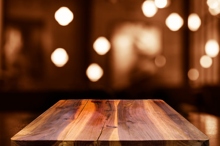 wooden surface: Empty top wooden table and blur with bokeh background. For product display
