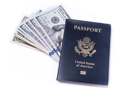 foreign nation: US passport and dollar bills on isolated white background