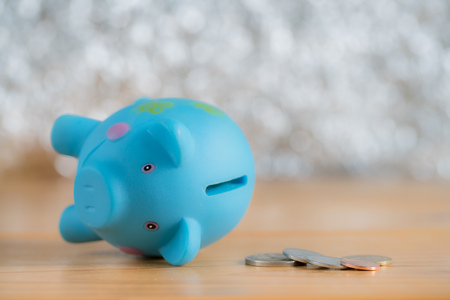 business failure: Piggy bank broken down with coins on wooden table, concept for business failure or down Stock Photo
