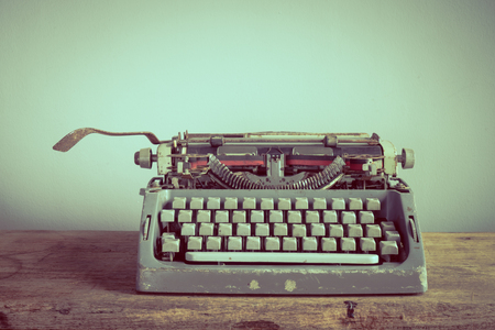 Still life with old typewriter on wooden table