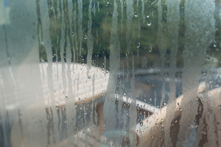 myst: Water drops from home condensation on a window