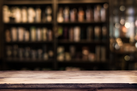 blurred background of bar and dark brown desk space of retro wood Stock Photo