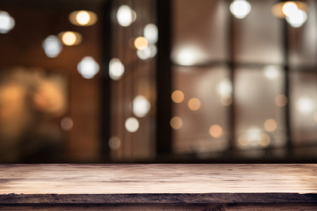 people  background: blurred background of bar and dark brown desk space of retro wood Stock Photo