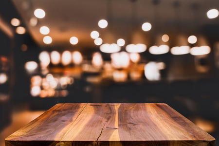 retro dark: blurred background of bar and dark brown desk space of retro wood Stock Photo