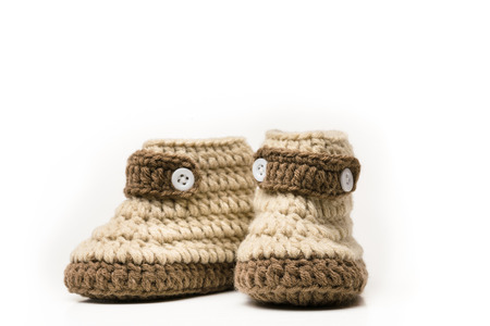 booty: brown shoes of baby on white background crochet baby booties isolated on white, Hand-made baby booties