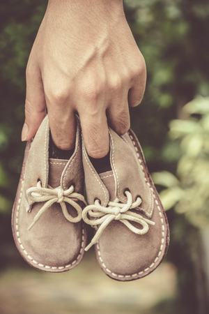 small leather boots, shoes in fathers hand Stock Photo