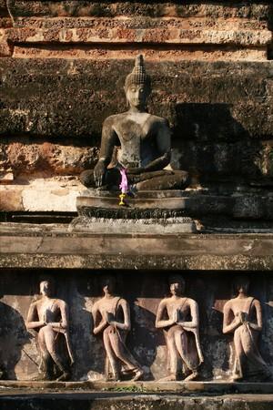 Stone Buddha statue,Sukhothai,Thailand. photo