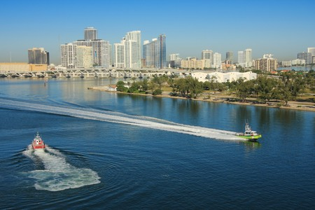 day time: Miami in day time and shore gard boat , Florida, USA.