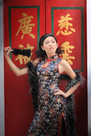 Young lady in black traditional chinese dress , Thailand. Stock Photo - 9018885