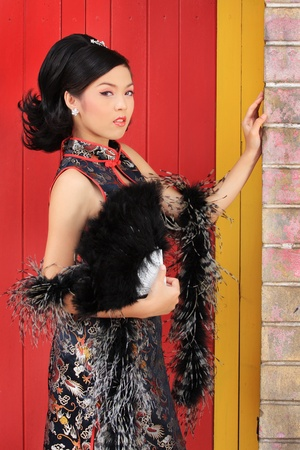 Young lady in black traditional chinese dress , Thailand. Stock Photo - 9018876
