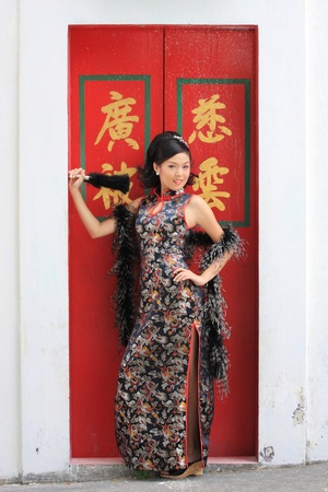 Young lady in black traditional chinese dress , Thailand. Stock Photo - 9018891