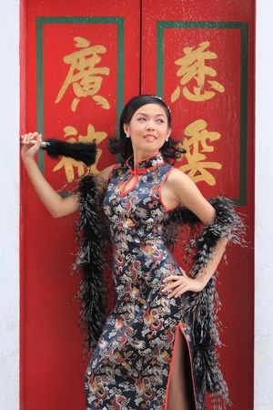 Young lady in black traditional chinese dress , Thailand. Stock Photo - 9018893