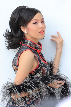 Young lady in black traditional chinese dress , Thailand. Stock Photo