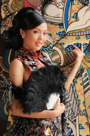 traditional celebrations: Young lady in black traditional chinese dress , Thailand. Stock Photo