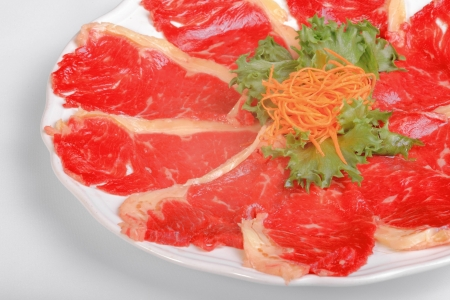 Beef steak on white dish and vegetable. photo