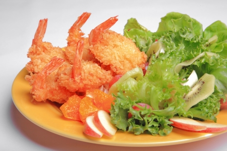Prawn salad on dish with vegetable amd fruit