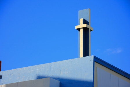 yellow jesus cross on top the Church of Christ florida