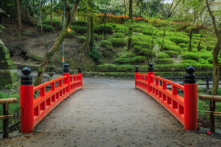 tunnel portals: The red pathway to temple in Japan.