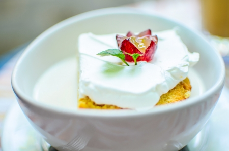 Tres Leches Cake in milk Stock Photo