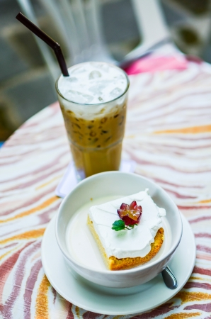 tres: Ice macchiato coffee and Tres Leches Cake in mike Stock Photo