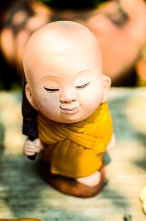 Monk ceramic statue photo