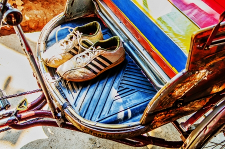 Shoes on tricycle