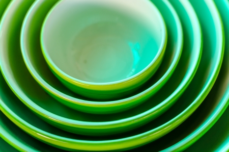Set of sequence sizing of green ceramic bowls Stock Photo