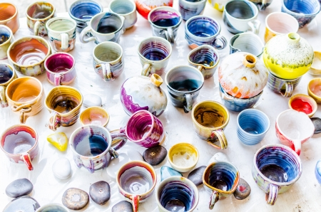 Colorful ceramic mugs photo